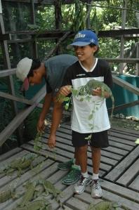 Brandon and Andrew feeding iguanas