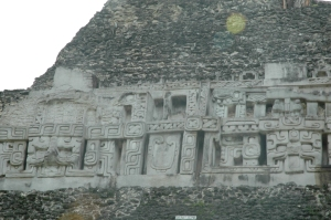 Masks on the side of the castillo