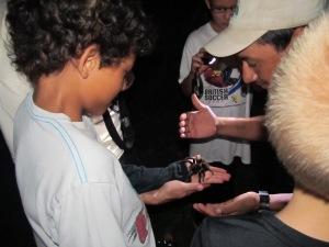 Brandon holds a tarantula
